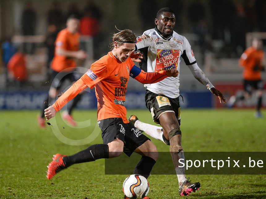 20160220 - ROESELARE, BELGIUM: Deinze's Hans Cornelis pictured in a duel with Roeselare's William Owusu Acheampong (r) during the Proximus League match between KSV Roeselare and KMSK Deinze , in Roeselare on Saturday 20 February 2016 , on the 26th matchday of the Belgian second division soccer championship. PHOTO DAVID CATRY