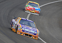 Oct. 11, 2009; Fontana, CA, USA; NASCAR Sprint Cup Series driver Jamie McMurray leads Kyle Busch during the Pepsi 500 at Auto Club Speedway. Mandatory Credit: Mark J. Rebilas-