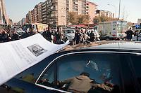Roma 28 Novembre 2011.Inaugurata la nuova Stazione Tiburtina dell'alta velocità..L'automobile del Presidente della Repubblica Giorgio Napolitano passa tra i  lavoratori della Wagon-Lits licenziati.