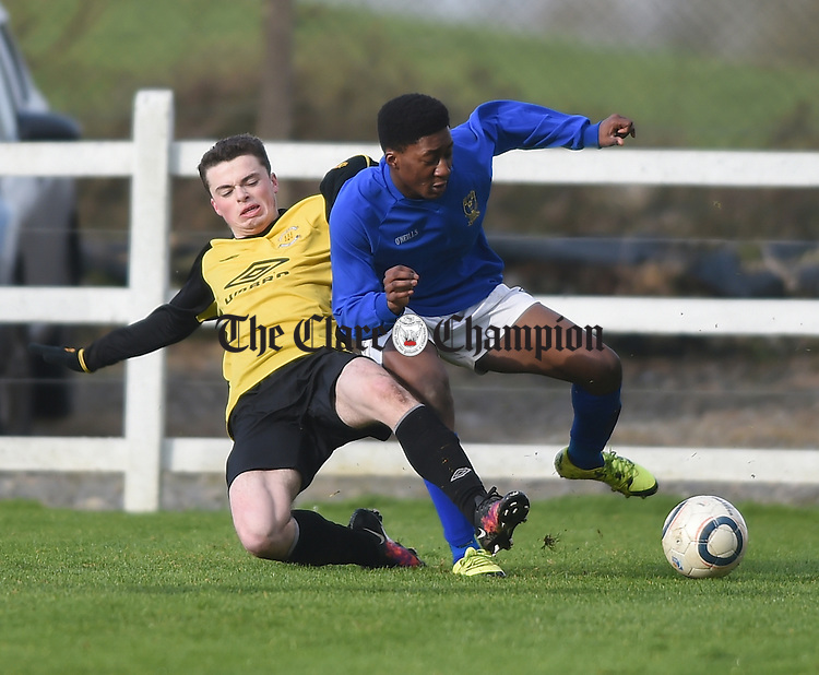 Chris Aylward of Kilkenny in action against Michael Junaid of Clare during their National  Inter-League Youths Cup game in Doora. Photograph by John Kelly.
