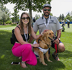Veronica and Bryan Peterson with support dog Judge during the Barracuda Championship PGA golf tournament at Montrêux Golf and Country Club in Reno, Nevada on Thursday, July 25, 2019.