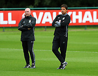 Squad psychologist Ian Mitchell and manager Chris Coleman observe the players warm up during the Wales Training Session at the Vale Resort, Hensol, Wales, UK. Tuesday 29 August 2017