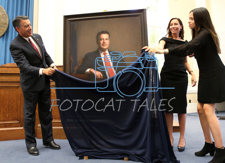 Gov. Brian Sandoval unveils his official portrait during a ceremony at the Capitol in Carson City, Nev., on Thursday, Oct. 25, 2018. His wife Lauralyn and his daughter Marisa were among the family members on had for the ceremony. <br />Photo by Cathleen Allison/Nevada Momentum