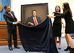 Gov. Brian Sandoval unveils his official portrait during a ceremony at the Capitol in Carson City, Nev., on Thursday, Oct. 25, 2018. His wife Lauralyn and his daughter Marisa were among the family members on had for the ceremony. <br />