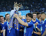 Leicester's Shinji Okazaki celebrates with the trophy  during the Barclays Premier League match at the King Power Stadium.  Photo credit should read: David Klein/Sportimage