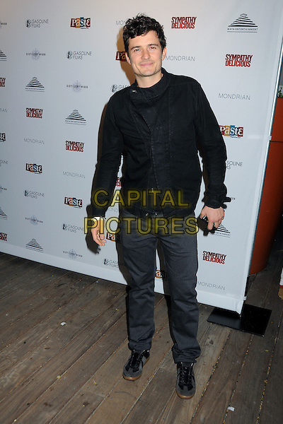 "ORLANDO BLOOM .""Sympathy for Delicious"" Release Party held at the Mondrian Hotel's SkyBar, .West Hollywood, California, .27th April 2011..full length black shirt jacket green tie grey gray trousers .CAP/ADM/BP.©Byron Purvis/AdMedia/Capital Pictures."