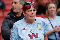 An Aston Villa fan with her hair in team colours during the Premier League match between Arsenal and Aston Villa at the Emirates Stadium, London, England on 22 September 2019. Photo by Carlton Myrie / PRiME Media Images.