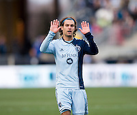 Graham Zusi (8) of Sporting Kansas City apologizes for a bad passduring the game at PPL Park in Chester, PA.  Kansas City defeated Philadelphia, 3-1.