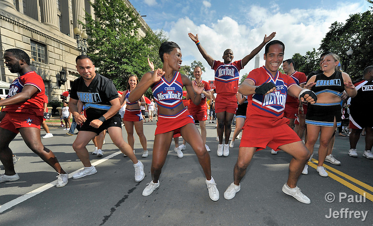 Cheer leaders perform in the street during a march in the center of Washington, DC, on July 22, 2012, to demand that the U.S. and other governments keep their promises to fund global relief programs for those living with HIV and AIDS. The rally took place as more than 23,000 delegates gathered in the US capital city for the XIX International AIDS Conference.