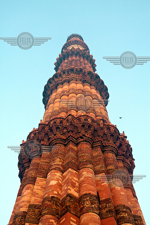 The Qutb Minar. The 73 metre high tower of victory was built in 1193 by Qutab-ud-din Aibak immediately after the defeat of Delhi's last Hindu kingdom.