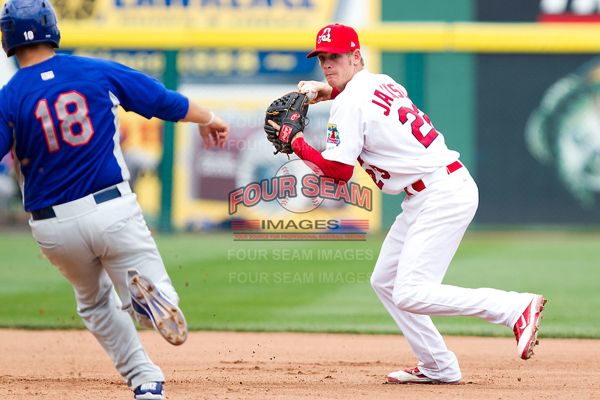Ryan Jackson (23) of the Springfield Cardinals turns a double play as Michael Spina (18) of the Midland RockHounds attempts to get in the way during a game against the Midland RockHounds on April 19, 2011 at Hammons Field in Springfield, Missouri.  Photo By David Welker/Four Seam Images