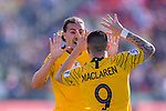 Jamie Maclaren of Australia celebrates scoring the team's first goal with teammate Jackson Irvine during the AFC Asian Cup UAE 2019 Group B match between Palestine (PLE) and Australia (AUS) at Rashid Stadium on 11 January 2019 in Dubai, United Arab Emirates. Photo by Marcio Rodrigo Machado / Power Sport Images
