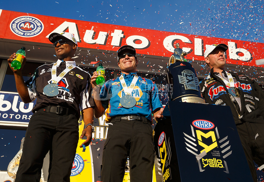 Nov 13, 2016; Pomona, CA, USA; (From left) NHRA top fuel driver Antron Brown , funny car driver Ron Capps and pro stock driver Jason Line celebrate after winning the 2016 world championships following the Auto Club Finals at Auto Club Raceway at Pomona. Mandatory Credit: Mark J. Rebilas-USA TODAY Sports