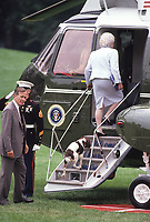 Washington DC., USA,  1990<br /> President George H.W. Bush. follows his wife Barbara and her dog Millie onto Marine One for quick flight up to the Presidential retreat Camp David in the  Catoctin Mountains of Maryland. Credit: Mark Reinstein/MediaPunch