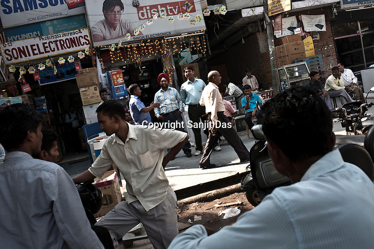 Vendors and customers in an electronics and consumables market in New Delhi, India. Photo: Sanjit Das