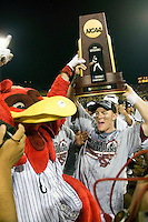 South Carolina's Adam Matthews lifts the championship trophy following Game Two of the NCAA Division One Men's College World Series Finals on June 29th, 2010 at Johnny Rosenblatt Stadium in Omaha, Nebraska.  (Photo by Andrew Woolley / Four Seam Images)