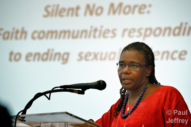 "The Rev. Dr. Nyambura Njoroge, an HIV project official with the World Council of Churches, speaks at a July 20 reception for the ""We Will Speak Out"" Coalition, which seeks to end sexual violence across communities around the world. The reception took place during the Interfaith Pre-Conference on HIV, held at Howard University in Washington, D.C., July 20-21, 2012, on the eve of the XIX International AIDS Conference. (An EAA photo by Paul Jeffrey.)"