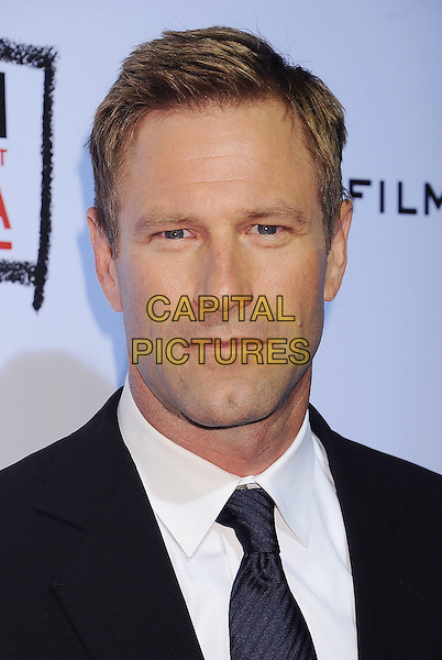 "Aaron Eckhart.arriving at the Los Angeles Premiere of ""The Rum Diary"" at LACMA in Los Angeles, California, USA, .October 13th 2011. .portrait headshot  navy blue tie  black suit white shirt .CAP/ROT/TM.©TM/Roth Stock/Capital Pictures"
