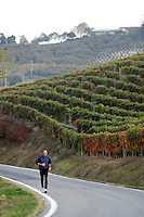 Uno scorcio della strada tra Alba e Ceva.<br /> A jogger makes his way along the road between Alba e Ceva, in Piedmont.<br /> UPDATE IMAGES PRESS/Riccardo De Luca