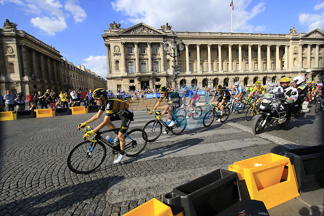 The peloton with Team Sky on the front arrive on Place de la Concorde during Stage 21 of the 2016 Tour de France, running 113km from Chantilly to Paris Champs-Elysees, France. 24th July 2016.<br /> Picture: Eoin Clarke | Newsfile<br /> <br /> <br /> All photos usage must carry mandatory copyright credit (&copy; Newsfile | Eoin Clarke)