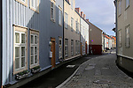 Historic street old housing in city centre Nedre Bakklandet area, Trondheim, Norway