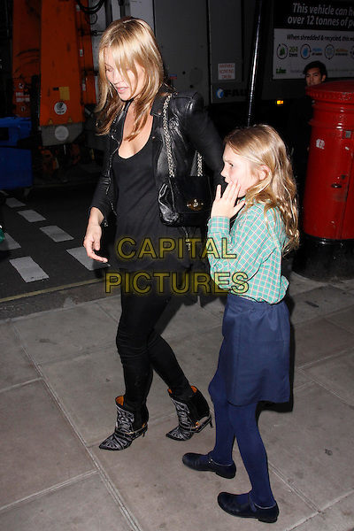 Kate Moss & Lila Grace Moss.Debbi Clark : an exhibition of portraits - private view, The Strand Gallery, London, England. .8th May, 2013.full length black leather jacket top jeans denim green check shirt blue skirt daughter mother mom mum side profile .CAP/AH.©Adam Houghton/Capital Pictures.
