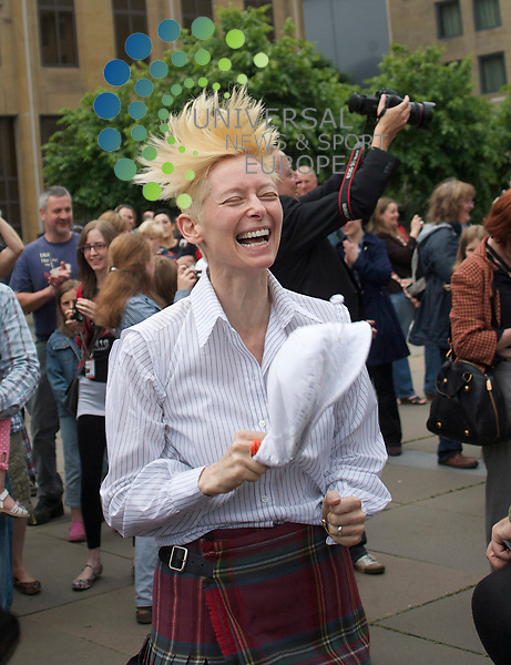 Tilda Swinton,  8  1/2 foundation launch Flash Mob Dance..Edinburgh -  26-06-10..Scottish Actress Tilda Swinton (The White Witch/ Queen of Narnia  in CS Lewis's The Lion The Witch and The Wardrobe) was in Edinburgh today to Launch her 8  1/2 Foundation's Flashmob Dance.  The Dance is a tribute to Laurel and Hardy, The foundation is there to introduce 8 and a Half yr old kids to the Festival. and Film in general...At Festival Square,  Edinburgh...Picture: Mark Davison/Universal News and Sport (Scotland) 26/06/2010