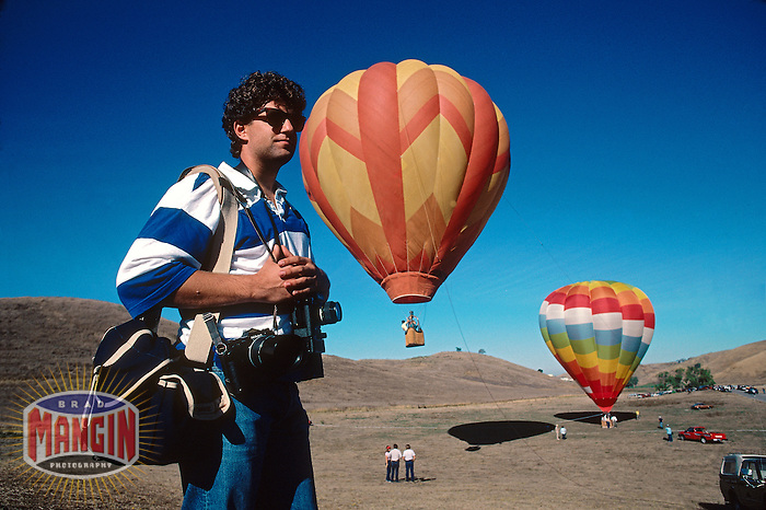 MILPITAS, CA - Photographer Joe Gosen works during the Silent Airshow at Ed Levin Park in Milpitas, CA in 1986. (Photo by Brad Mangin)