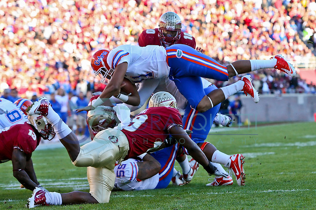 November 27, 2010:    Florida Gators quarterback Jordan Reed (11) dives over Florida State Seminoles defenders for yardage during  first half game action between the ACC Conference Florida State Seminoles and the SEC Conference University of Florida Gators at Doak Campbell Stadium in Tallahassee, Florida.
