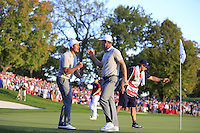 Henrik Stenson (SWE) and Justin Rose (ENG)(Team Europe) and Patrick Reid (Team USA) on the 16th green during Saturday afternoon Fourball at the Ryder Cup, Hazeltine National Golf Club, Chaska, Minnesota, USA.  02/10/2016<br /> Picture: Golffile | Fran Caffrey<br /> <br /> <br /> All photo usage must carry mandatory copyright credit (&copy; Golffile | Fran Caffrey)