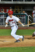 Jack Kruger (34) of the Orem Owlz follows through on his swing against the Billings Mustangs in Game 2 of the Pioneer League Championship at Home of the Owlz on September 16, 2016 in Orem, Utah. Orem defeated Billings 3-2 and are the 2016 Pioneer League Champions.(Stephen Smith/Four Seam Images)