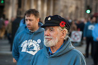 Veterans for Peace mark Remembrance Sunday at the London Cenotaph. 9-11-14 The organisation of ex servicement set up to peacefully oppose war marched to the Cenotaph from trafalgar Square and laid a wreath of predominantly White poppies.