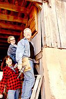 RACHEL DICKERSON/MCDONALD COUNTY PRESS Missouri Master Naturalist Joyce Haynes, left, joins Missouri Master Naturalists Joyce and Ron Johnson next to a bat house they installed in Haynes' barn.