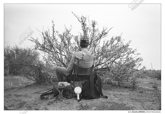 Chris Simcox, founder of Civil Homeland Defense, waits for a group of illegal aliens to cross his path. Cochise County, Arizona, July 6, 2003.