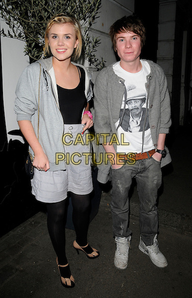 "JOSEPH DEMPSIE & GUEST.At the ""Beyond The Rave"" Launch Party,.Shoreditch House London, England,.16th April 2008..full length grey gray  top jacket shorts black tights  hoodie jeans trainers.CAP/CAN.©Can Nguyen/Capital Pictures"