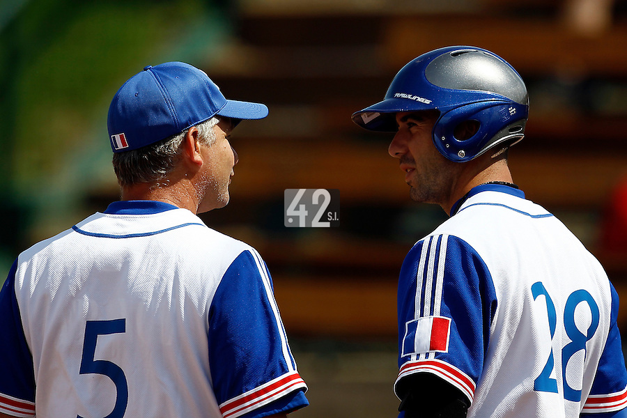 21 June 2011: Pierrick Le Mestre of Team France talks to Guillaume Coste during UCLA Alumni 5-3 win over France, at the 2011 Prague Baseball Week, in Prague, Czech Republic.