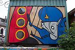 Graffiti depicting the police crackdown on the free town of Christiania, in Copenhagen Denmark
