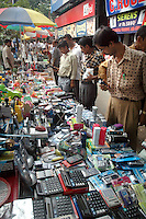 Indian men buying pirated electronic goods on a foot path  in Kolkata, West Bengal,  India  7/18/2007.  Arindam Mukherjee/Landov