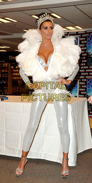 """JORDAN - KATIE PRICE .Launches her new book """"Angel Uncovered"""" at Borders book store, London, England. .July 17th, 2008 .full length silver sequins sequined feathers feathered collar jewel encrusted crown plunging neckline cleavage bra catsuit jumpsuit hands on hips belt.CAP/WIZ.© Wizard/Capital Pictures."""