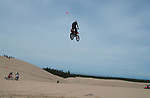 Dirt bike jumping dunes on the Oregon sand dunes