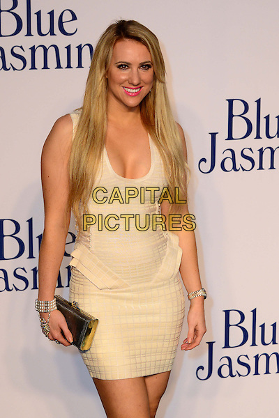 Rebecca Ferdinando<br /> UK Premiere of 'Blue Jasmine' at the Odeon West End, Leicester Square. London, England.<br /> 17th September 2013<br /> half length white dress clutch bag gold<br /> CAP/BF<br /> &copy;Bob Fidgeon/Capital Pictures