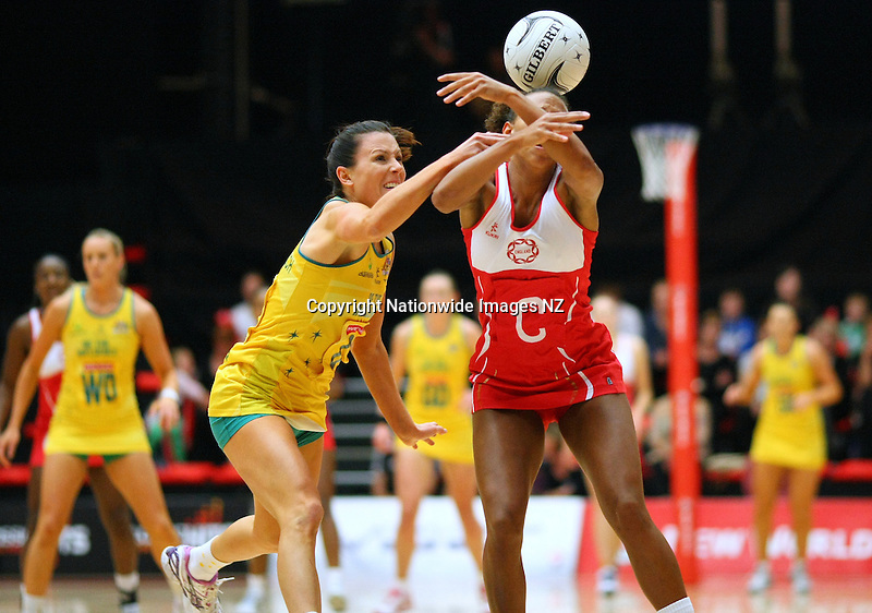 Australia's Natalie von Bertouch, left, and England's Serena Guthrie compete for the ball in the New World Quad series netball match, TECT Arena, Tauranga, New Zealand, Sunday, October 28, 2012. Credit:NINZ / Dianne Manson.