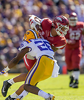 NWA Democrat-Gazette/BEN GOFF @NWABENGOFF<br /> Jeremy Patton, Arkansas tight end, tries to break the tackle of John Battle, LSU strong safety, after a catch in the second quarter Saturday, Nov. 11, 2017 at Tiger Stadium in Baton Rouge, La.