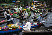 Vendors sell vegetables and flowers at the floating market on Dal Lake in Srinagar, Jammu and Kashmir, India.