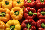 Red and yellow bell peppers at farmers market