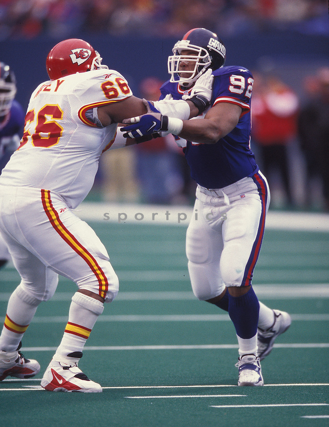 New York Giants, Michael Strahan (92) during a game against the Kansas City Chief on December 20, 1998 at Giants Stadium in East Rutherford, New Jersey.  The Giants beat the Chiefs 28-7. Michael Strahan played for 15 years all with the Giants.  He was a 7-time Pro Bowler and was inducted to the Pro Football Hall of Fame in 2014.
