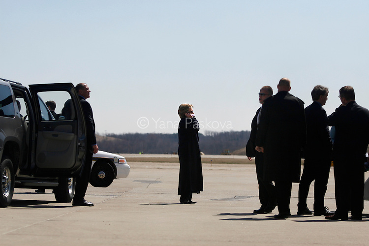 After a day of campaign stops, U.S. Presidential hopeful Hillary Clinton (D-NY) talks on the phone as she and her staff prepare to depart the Pittsburgh International Airport in Pittsburgh, Pennsylvania, to San Francisco, California, on Wednesday, April 02, 2008. The Senator is hoping to woo crucial to her votes in Pennsylvania before its primary on April 22, 2008. (Photograph by Yana Paskova for Newsweek)