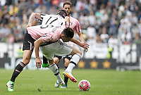 Calcio, Serie A: Juventus vs Palermo. Torino, Juventus Stadium, 17 aprile 2016.<br /> Juventus&rsquo; Mario Mandzukic, right, is challenged by Palermo&rsquo;s Edoardo Goldaniga during the Italian Serie A football match between Juventus and Palermo at Turin's Juventus Stadium, 17 April 2016.<br /> UPDATE IMAGES PRESS/Isabella Bonotto
