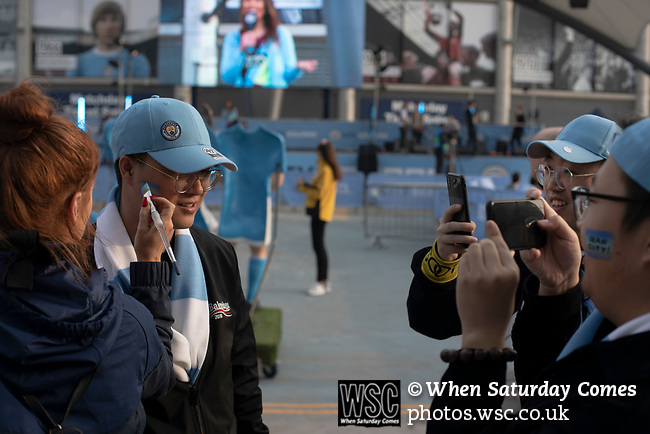 Manchester City 4, Tottenham Hotspur 3, 17/04/2019. Etihad Stadium, Champions League. A home supporter getting his face painted outside the Etihad Stadium before Manchester City played Tottenham Hotspur in a Champions League quarter final, second league. The first leg was played the previous week at Spurs' new stadium which they won 1-0. The second lead resulted in a 4-3 win for City however Tottenham progressed to the semi-finals against Ajax on the away goal rule as the teams finished 4-4 on aggregate. Photo by Colin McPherson.