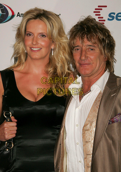 PENNY LANCASTER & ROD STEWART.Arrivals - 13th Annual Race to Erase MS held at the Hyatt Regency Century Plaza Hotel, Century City, California, USA, 12 May 2006..half elngth couple brown gold suit.Ref: ADM/RE.www.capitalpictures.com.sales@capitalpictures.com.©Russ Elliot/AdMedia/Capital Pictures.